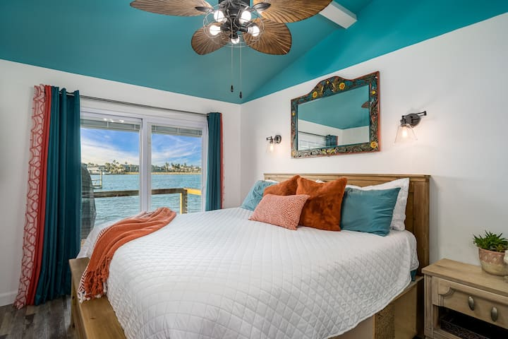 Master King size bed with sliding door out to the deck overlooking the bay.