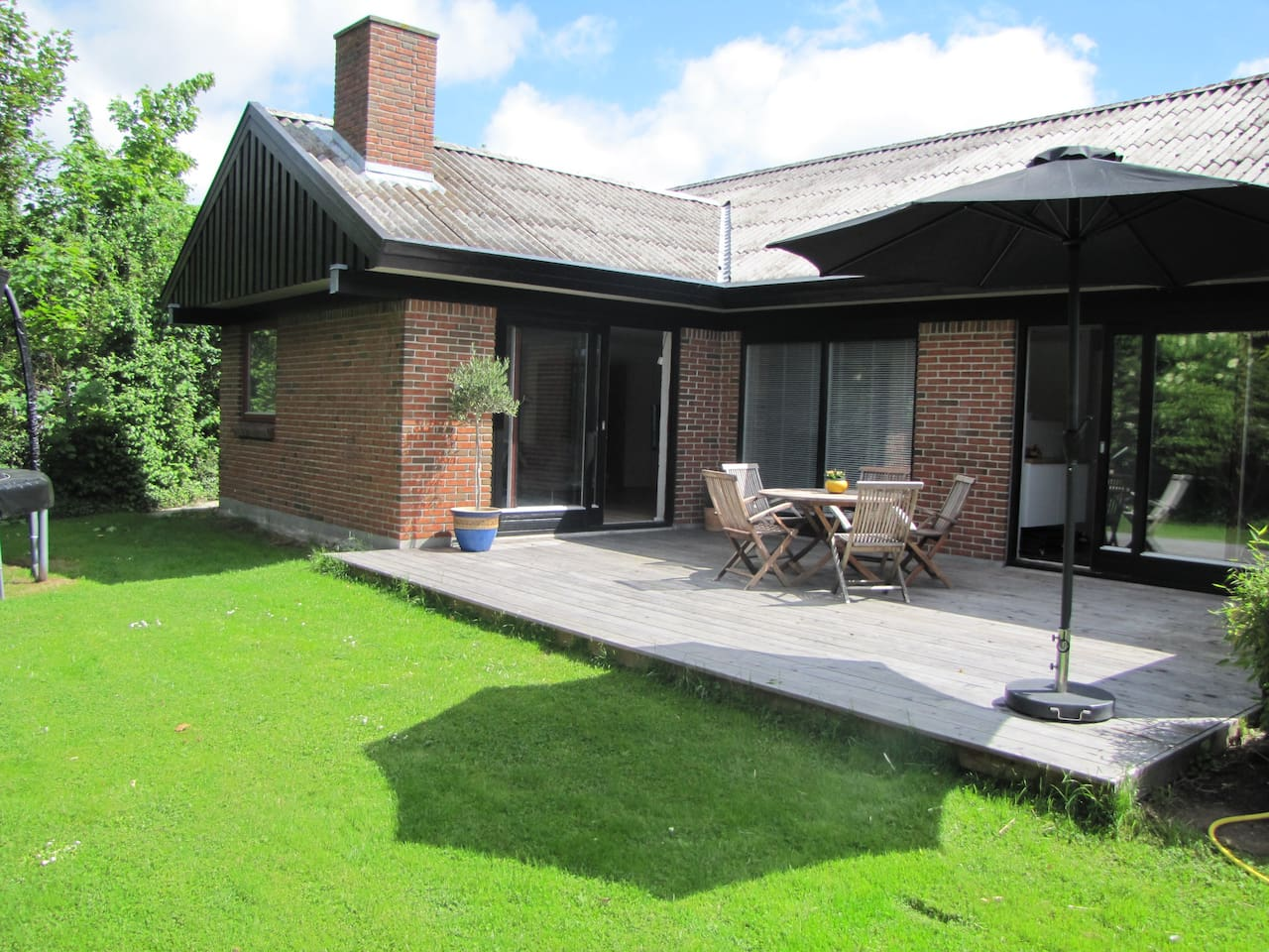 Nice terrace with garden furniture and grill