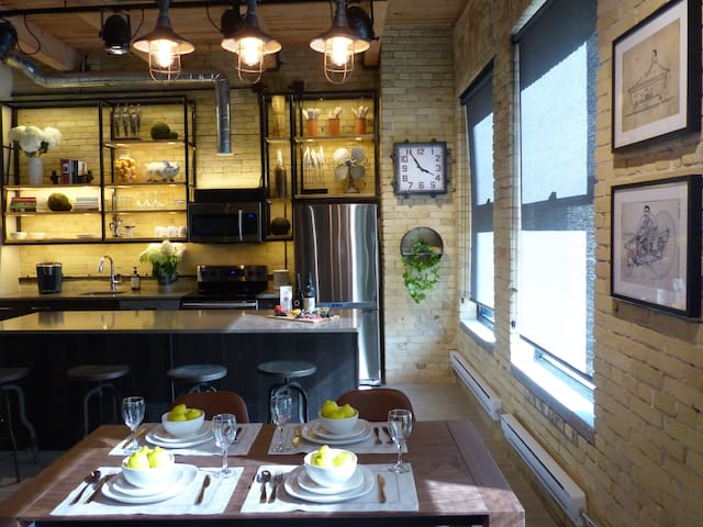 The kitchen with custom open shelving specifically designed to expose the brick