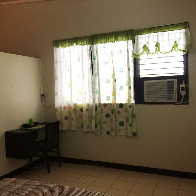 Bedroom # 2 with window type aircon and ceiling fan to make your stay comfortable.