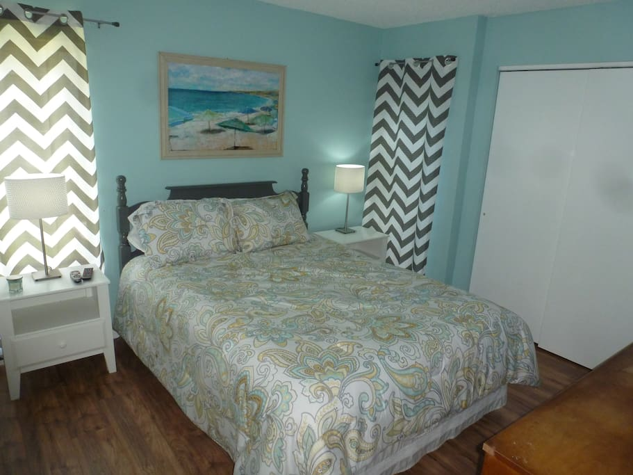 Blue Bedroom - Queen bed, two huge closets containing beach towels and extra sheets, and a laundry basket for your use during your stay.