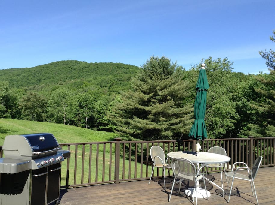 Summer deck view with grill and table.