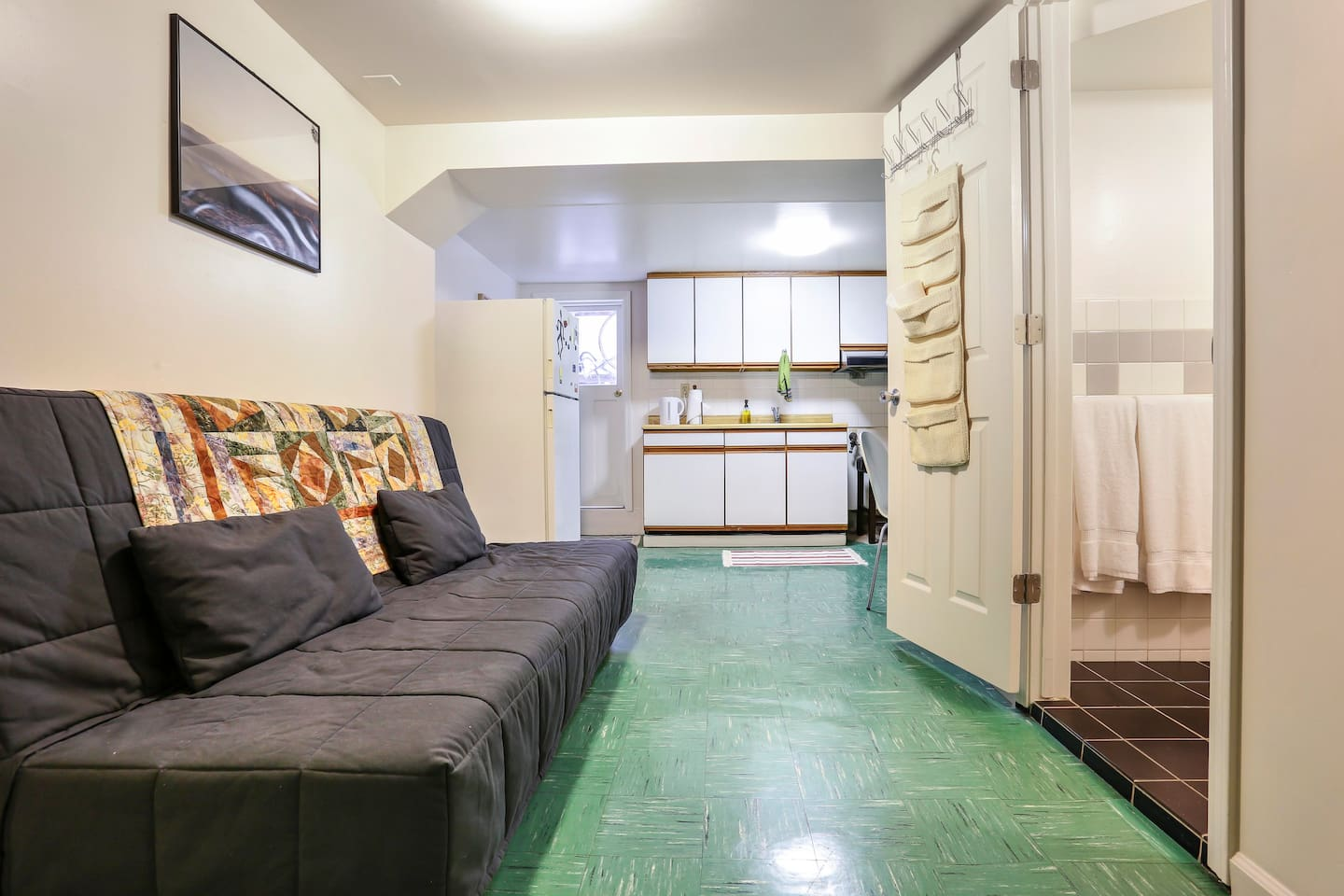 Futon and kitchenette with sink and microwave