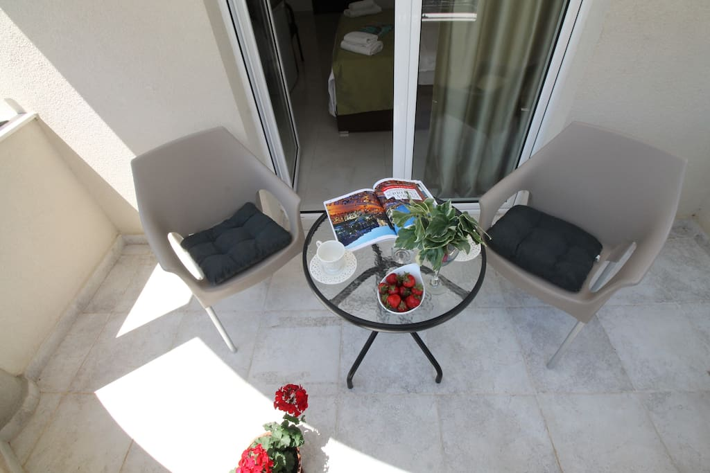 Balcony with table and chairs