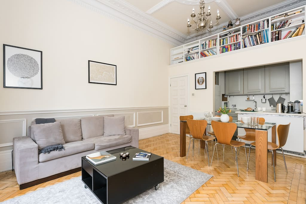 Large dining table, a library, and comfy sofa for TV watching