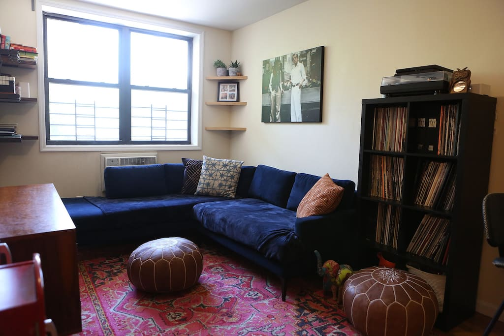 Bright, naturally lit living room with large windows (a rarity in NYC).