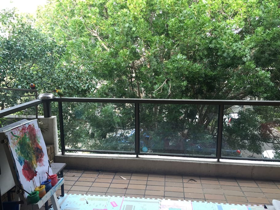 Large leafy outlook covered balcony space- with seating and Weber Q BBQ
