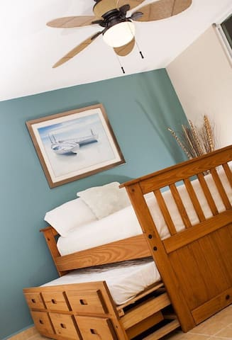 Full top bed with sliding under twin bed.
