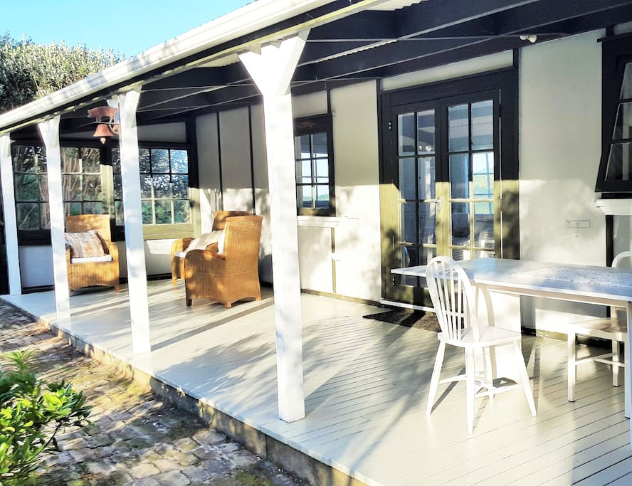 Expansive veranda with outdoor seating, dining and BBQ facilities.