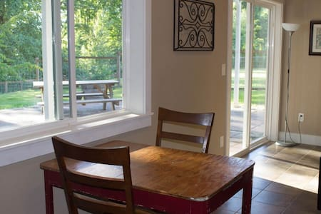 Wake to birds singing!  Large, private entry, daylight basement. Located on a great trail system.  A newly furnished bedroom(queen) and ensuite bathroom.  Can accommodate up to 5. Walk or ride your bike to Whatcom Falls Park & Barkley Village.