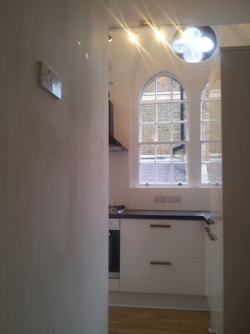 Large Gothic window. From sitting room into kitchen.