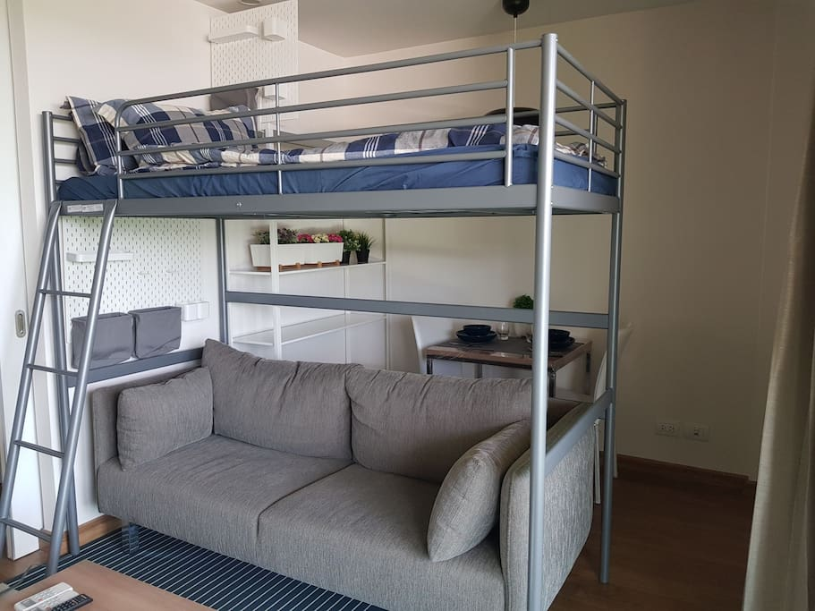 Bunk bed set with private wall storage and sofa underneath