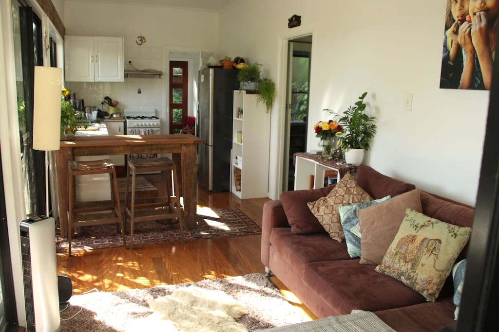 Beautiful SUNNY lounge and kitchen area. Rustic wooden bench.