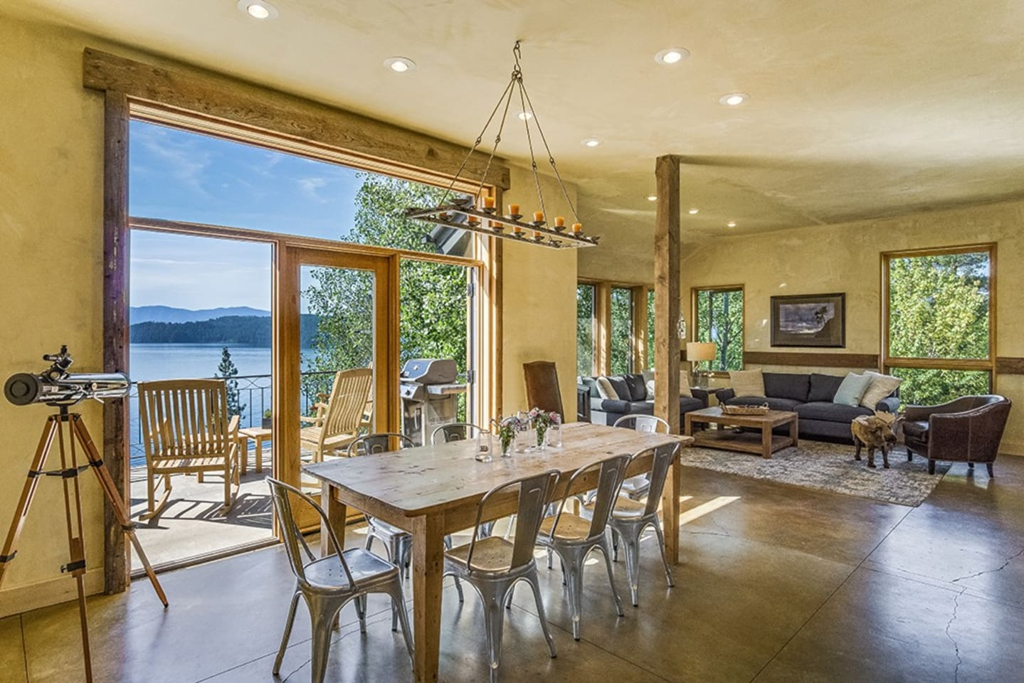 Large open area off the kitchen and den onto the main porch overlooking Lake Pend Oreille and the majestic Green Monarchs