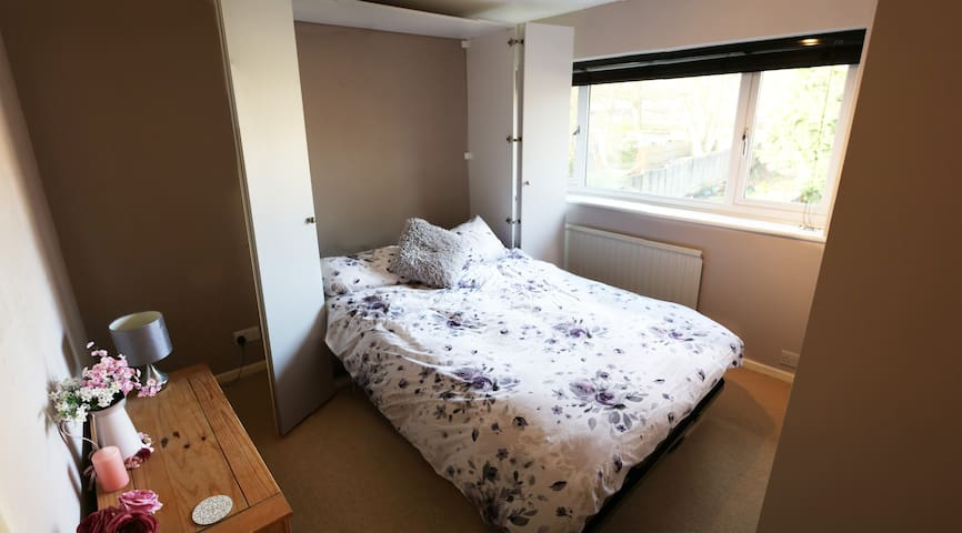 Nice double bed with shared bathroom