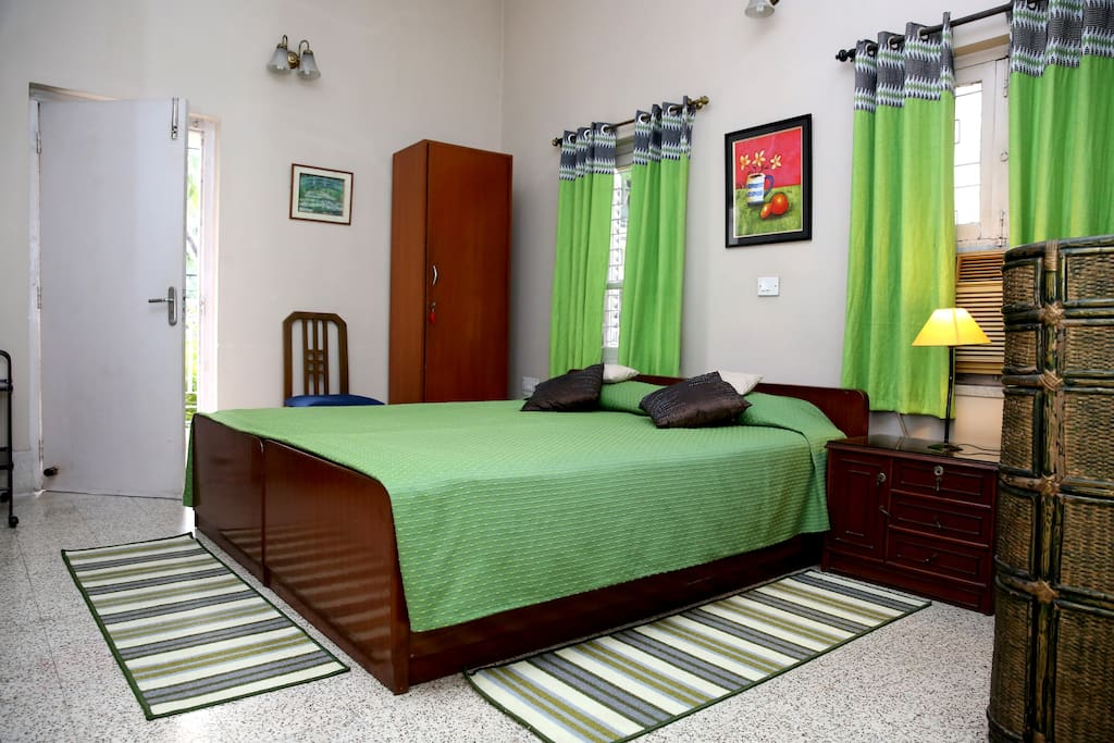 At Narayaniz Room 2 with a cupboard Chest drawers, TV with cable connection, bed with side tables and chair