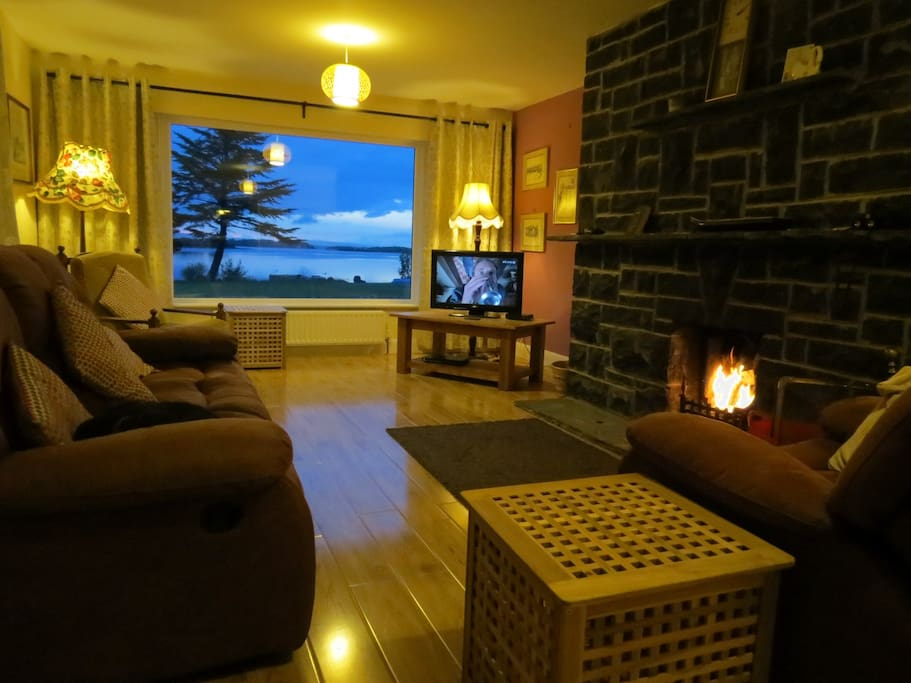 Sit by the fire , drink in the view of Lough Corrib