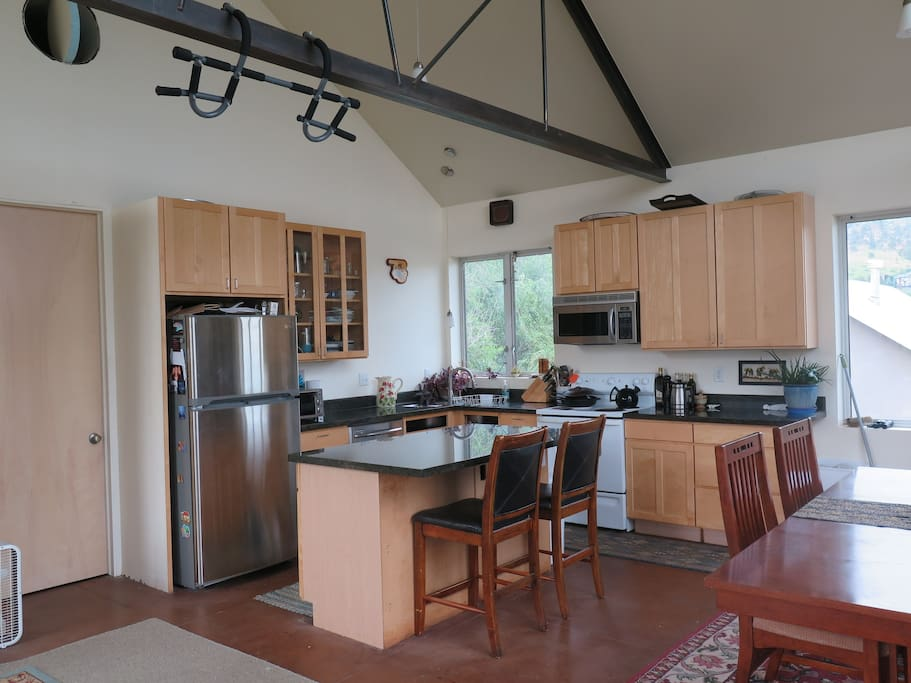 Kitchen with vaulted ceilings off the great room.