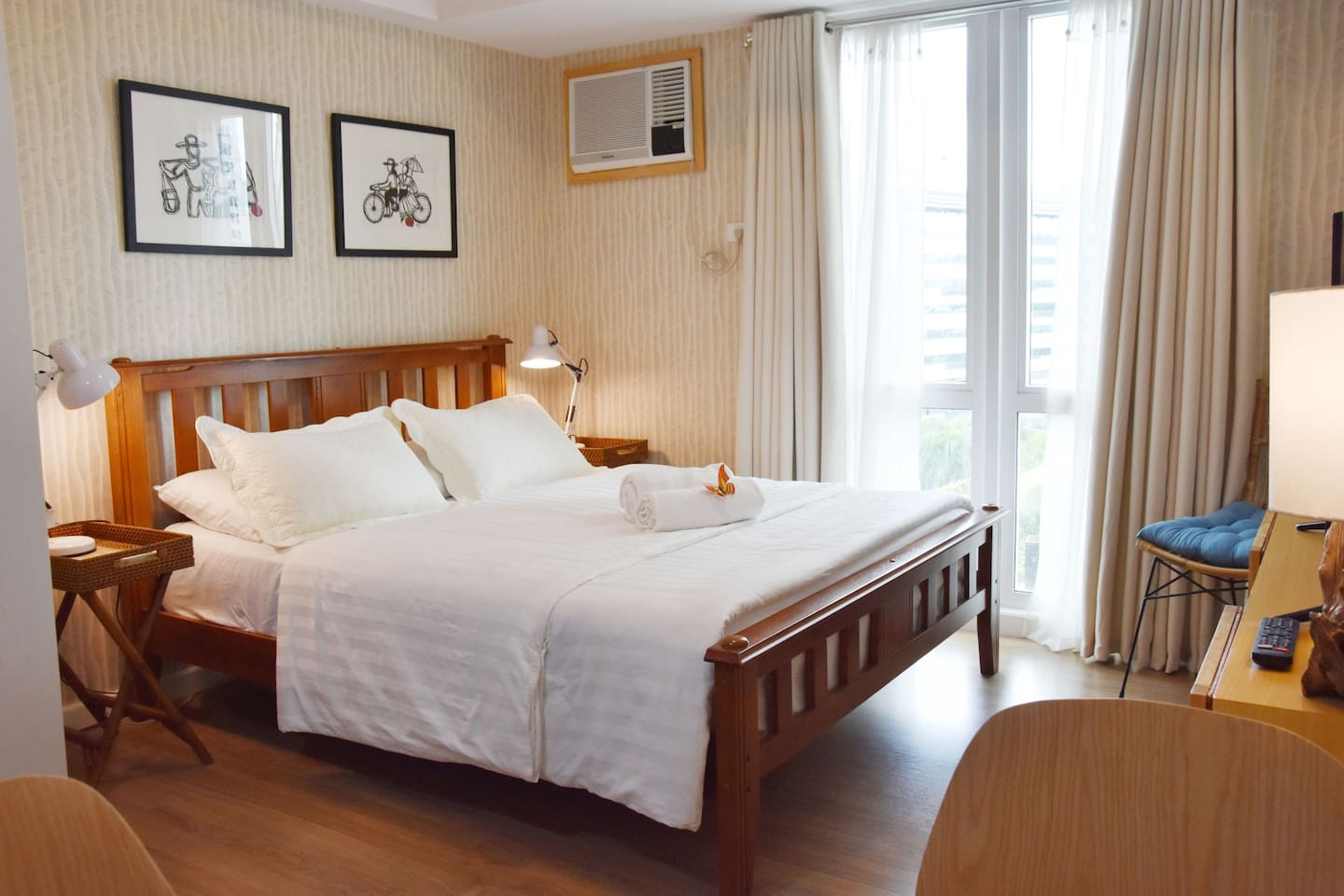 Comfy queen size bed overlooking the garden and play area.