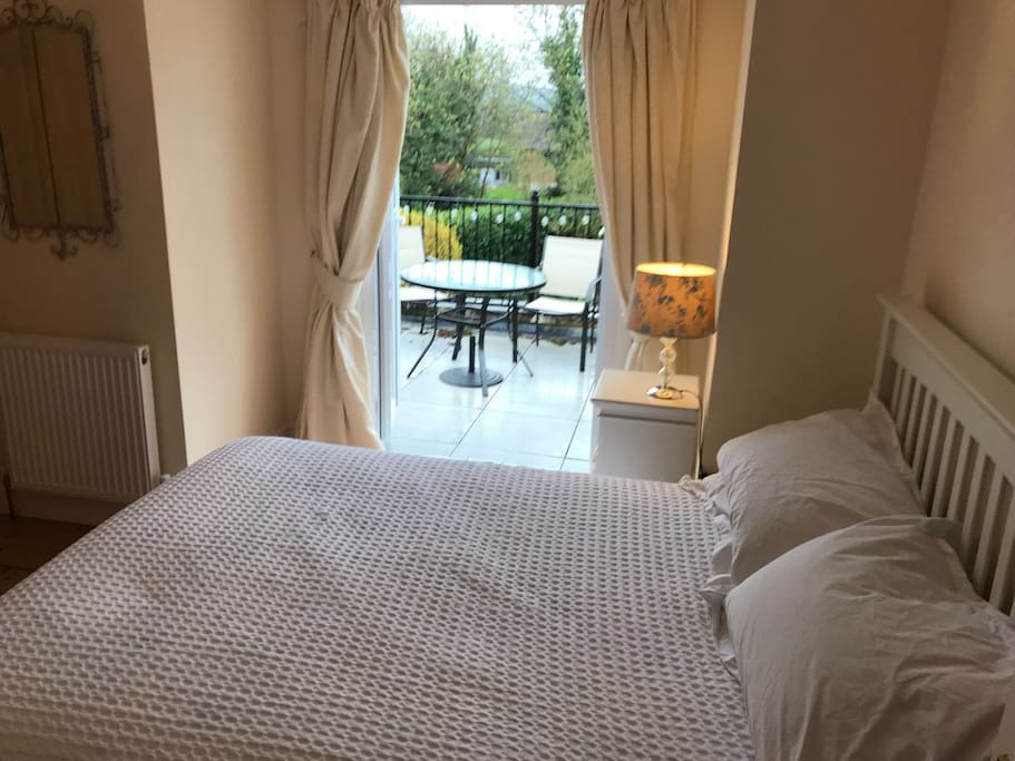 Double bedroom leading to upstairs dining and relaxing space that overlooks the garden