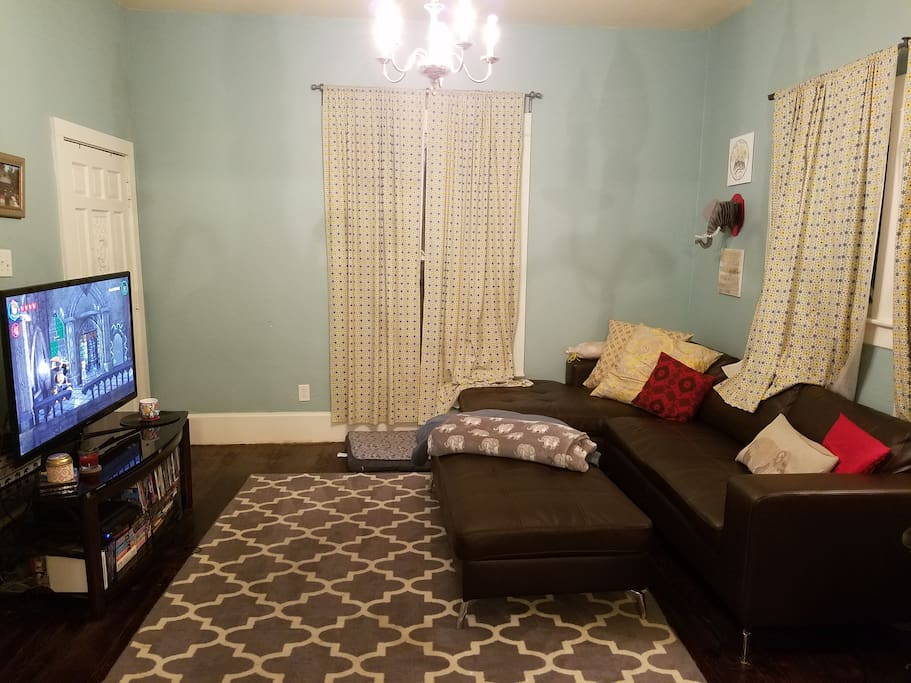 Comfy living room with big soft couch, dvd collection, board games, PS3, Wii and cable/DVR