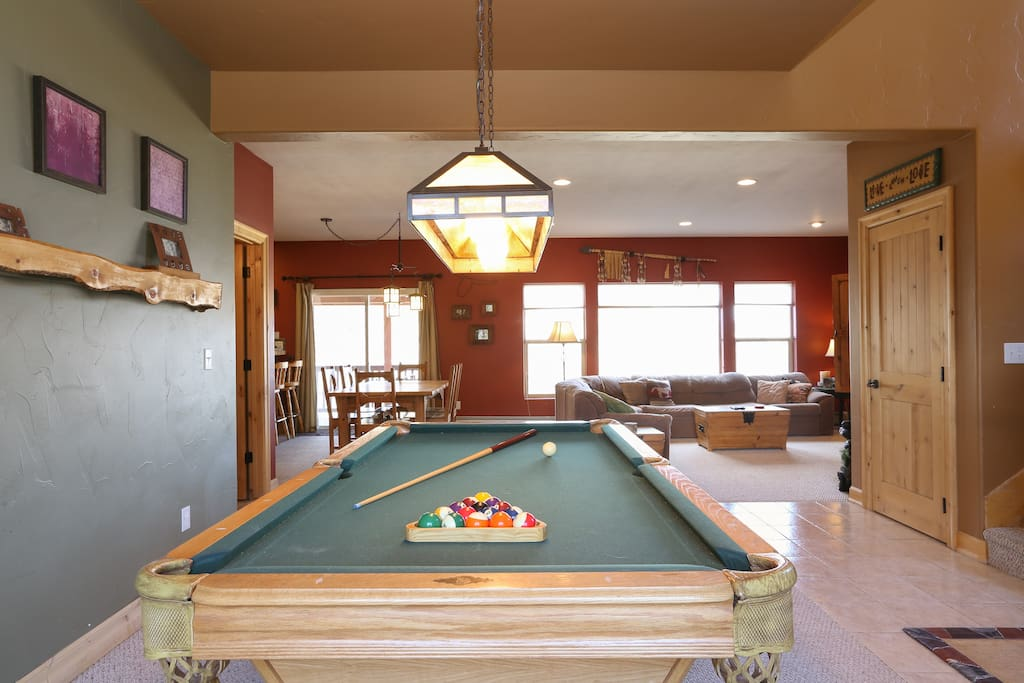 A full-size pool table is just off the living room.