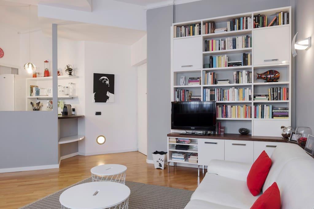 The living room (spacious bed sofa x2, TV, AC)