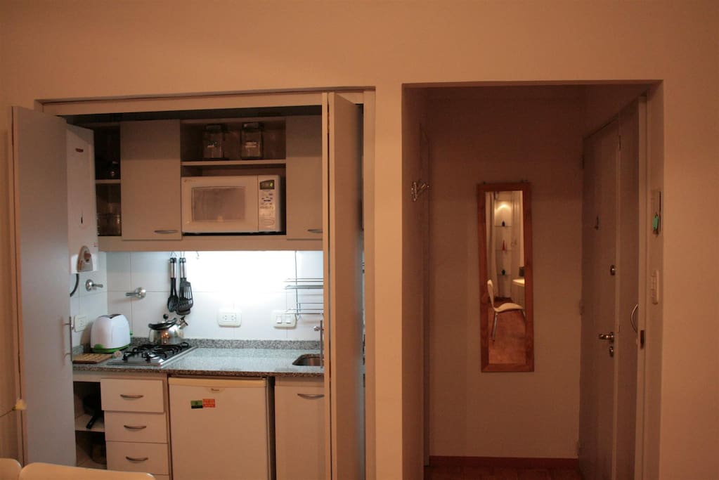 Kitchen with small fridge, microwave, toaster, and everything you need!