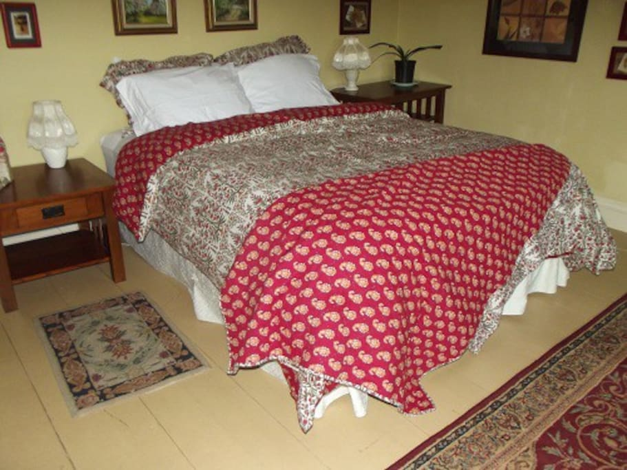 Queen Sized Bed with cotton sheets and feather pillows. View of the meadows, flowers, yards and forest.