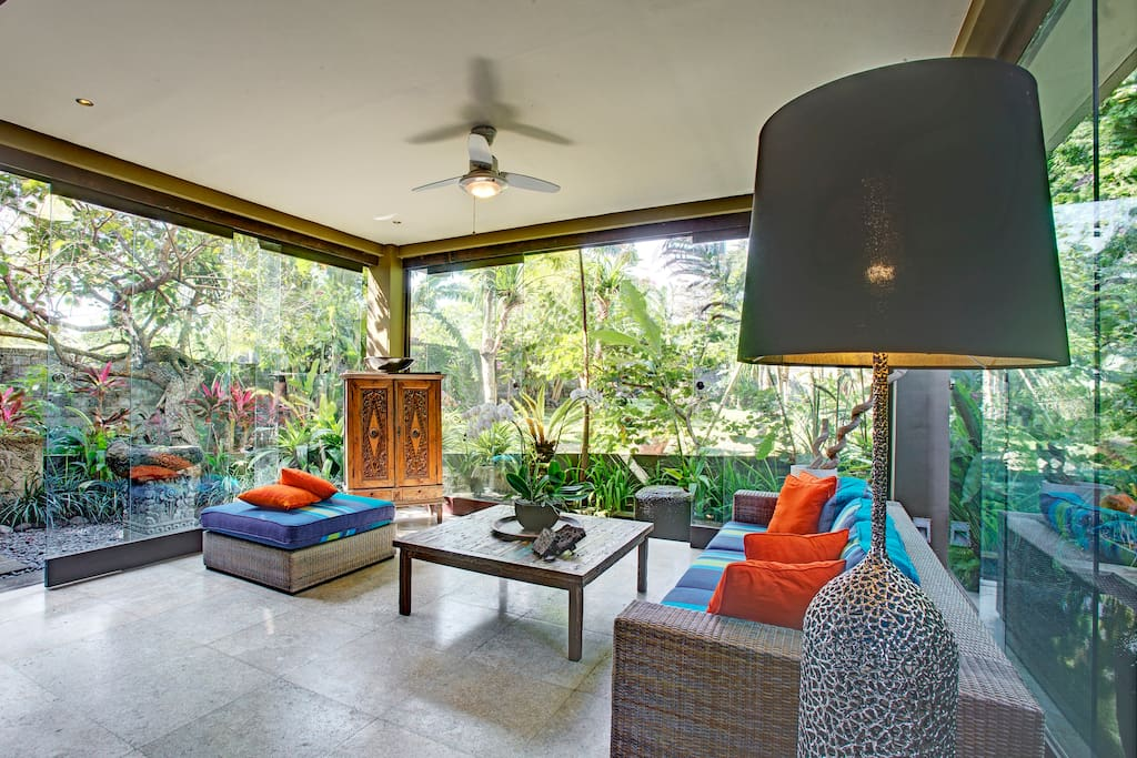 The living area has a television with cable TV, and is surrounded by sunken Koi ponds on two sides. The views from all sides is surrounded by tropical gardens.