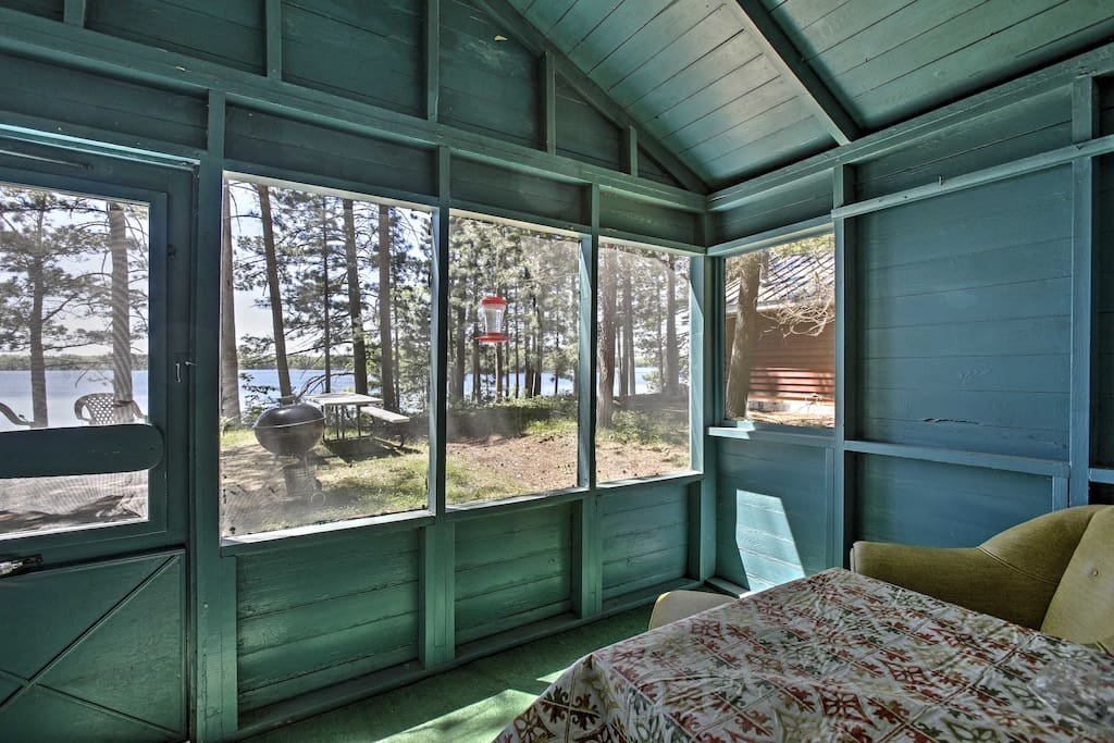 Wake up and relax on the screened-in porch that looks out upon the lake.