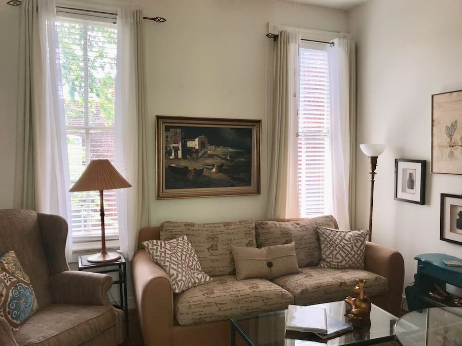 Cozy living room has reclining chair, comfy couch, dining-for-two table plus wide-screen TV, blue ray player, sound system