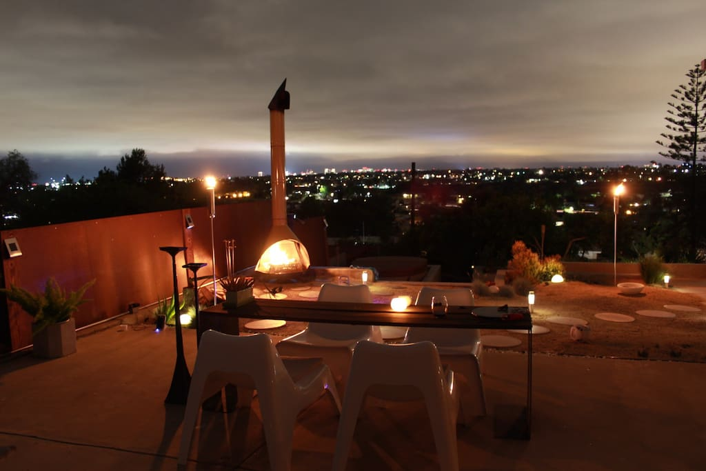 Night scene in the backyard. Make sure to enjoy the Tikis and outdoor fireplace. The result is truly amazing!