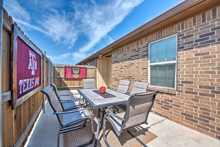 This vacation rental townhouse boasts a private patio with a grill and table.