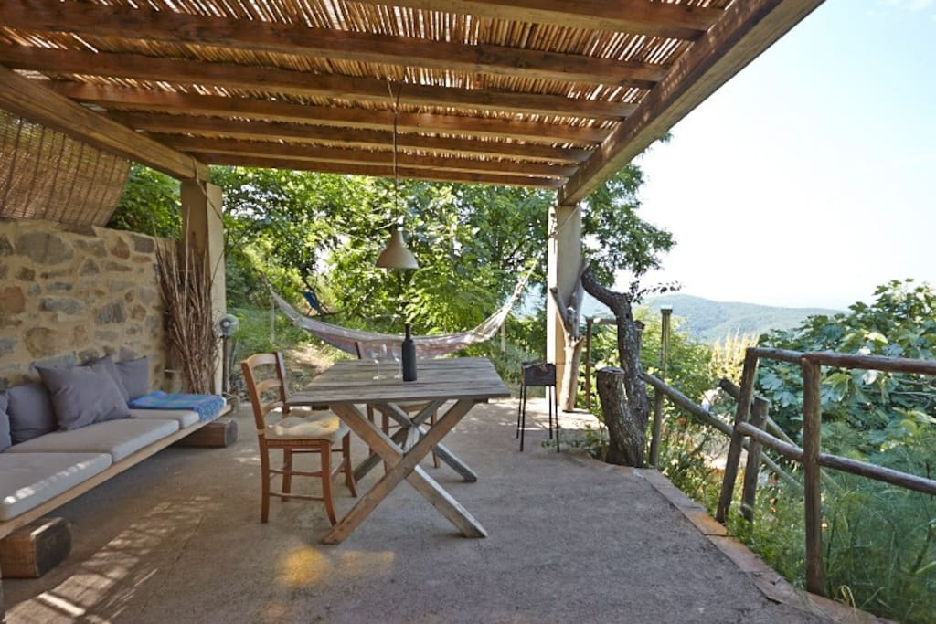 Casetta La Quercia with view terrace, alfresco kitchen and its private garden with endless views, hot tub and sun beds ...
