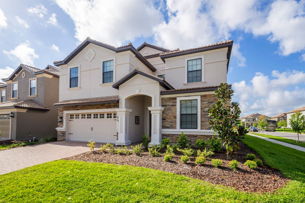 This stunning 8 bedroom vacation home in the beautiful ChampionsGate Resort is perfect for your Orlando area family vacation!