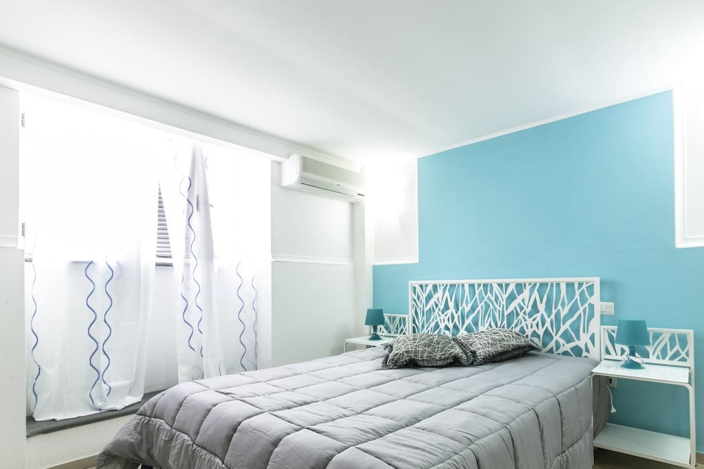 Master Bedroom, Bright in the Day with Great Shutters for Darkness