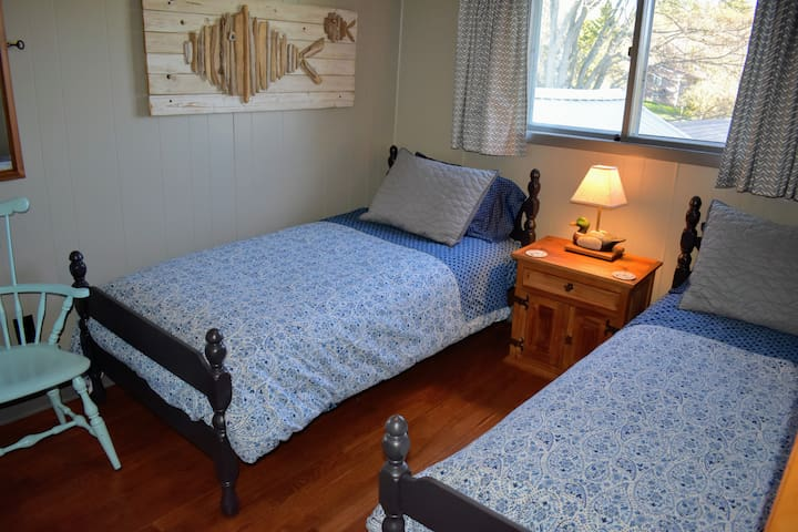 Bedroom #2: Two Twin Beds, New Mattresses, winter down comforters, soft summer quilts, vintage decor, 1 chair, 1 nightstand, mirror, wall hooks, luggage rack. Smaller than Master bedroom but super comfy!