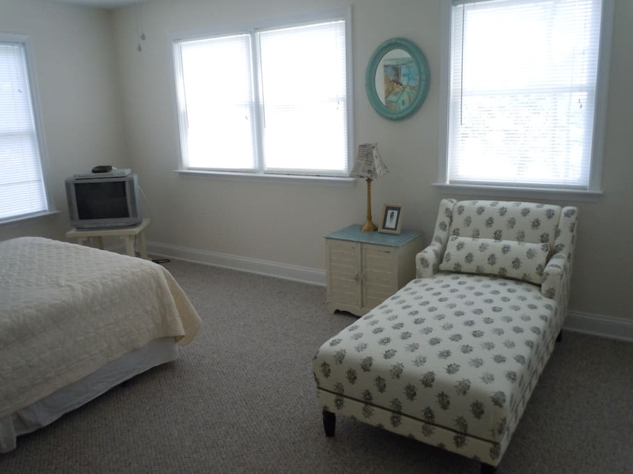 The upstairs master suite, queen-sized bed and chaise lounge