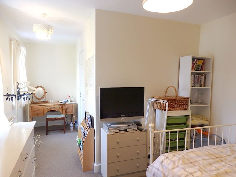 TV, DVD player, Dressing table, Clothes rail.