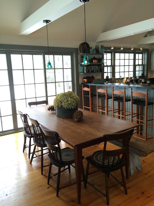 Spacious harvest table and bar in the kitchen that seats 15 or more.