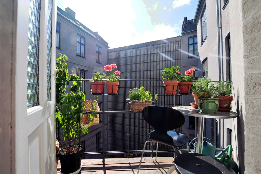 The small balcony is a nice spot for morning coffee.