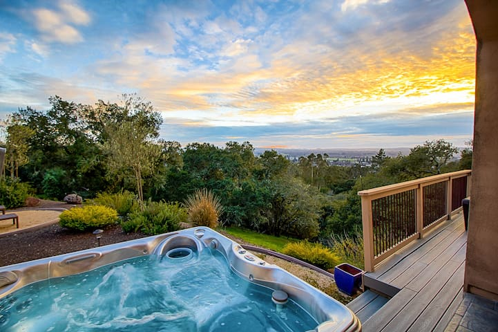 Enjoy your private hot tub with a view of the sunset over Santa Rosa