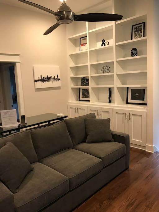 Living room has a comfy couch in front of the TV which can fold out into a queen memory foam bed.