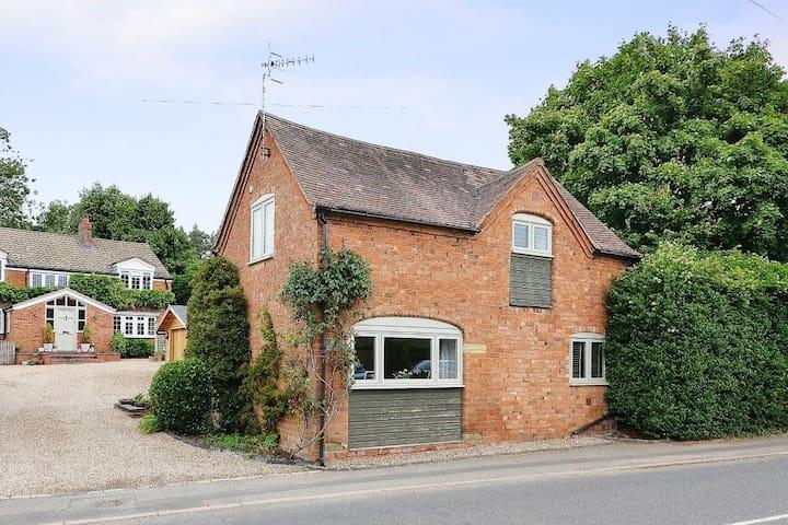 Quaint Victorian Coach House in village location