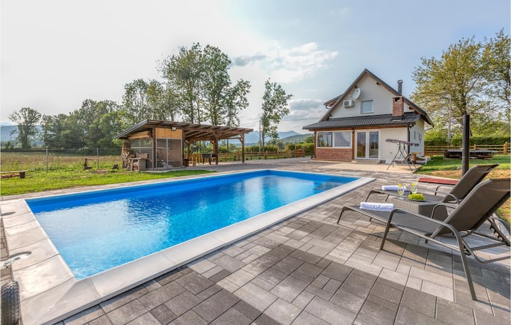 Beautiful home in Smiljan with Outdoor swimming pool, Sauna and 2 Bedrooms