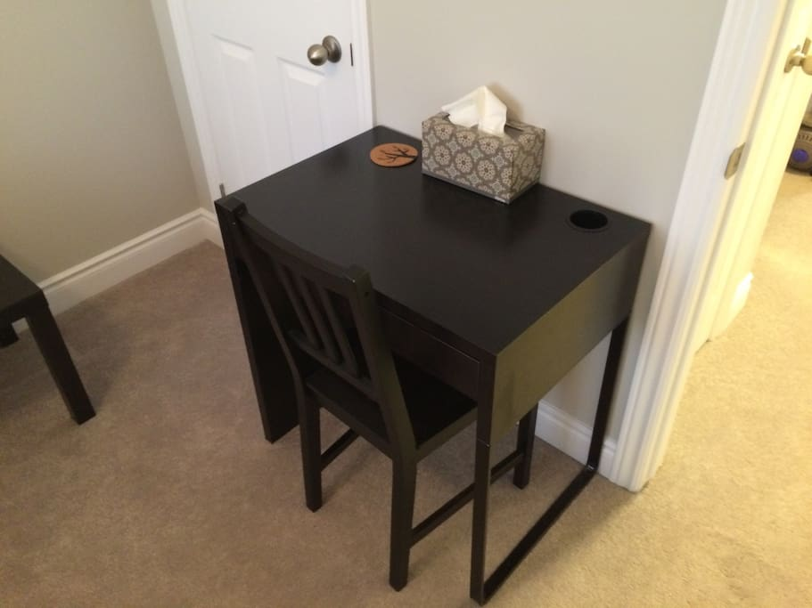 Desk with an outlet below and drawer. Free super fast wifi if you need to stream, download, etc.