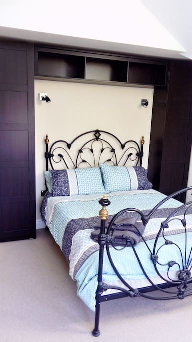 King size bed, Tempur Pedic mattress, fitted wardrobes