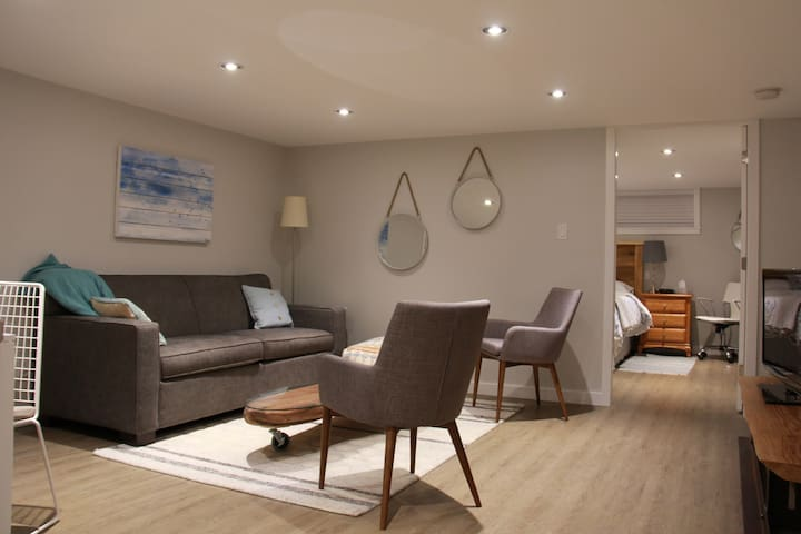 Spacious living area includes a queen size sofa bed with upgraded mattress.