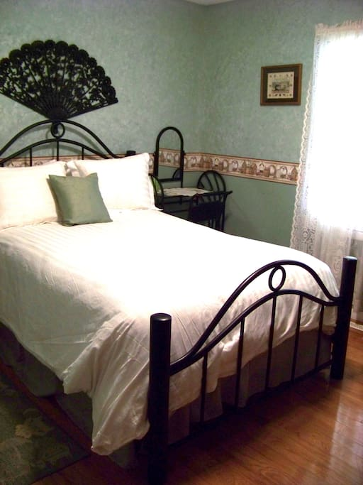 The bed frame is a replica of wrought iron frames of the past.